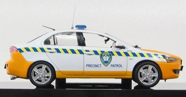 "Mitsubishi Lancer ""Precinct Patrol"" 2009 South Africa Traffic Police (Vitesse) [2007г., Белый, Желтый, 1:43]"