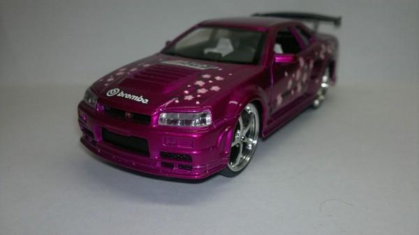 Nissan Skyline GTR 34 (Saico) [1999г., Розовый металлик, 1:32]
