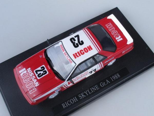 Nissan Skyline Gr.A No.23 1988 Ricoh (Ebbro) [1985г., Красный с белым, 1:43]