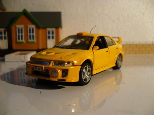Mitsubishi Lancer Evolution VI (подделка неизвестного производителя под TMT models) [1999г., ярко-желтый, 1:43]